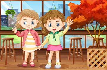 Two happy girls in restaurant