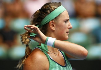 Belarus' Azarenka adjusts her hair during her quarter-final match against Germany's Kerber at the Australian Open tennis tournament at Melbourne Park