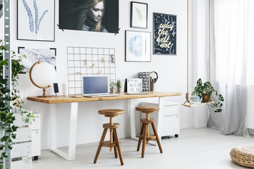 Double desk and two stools in home office