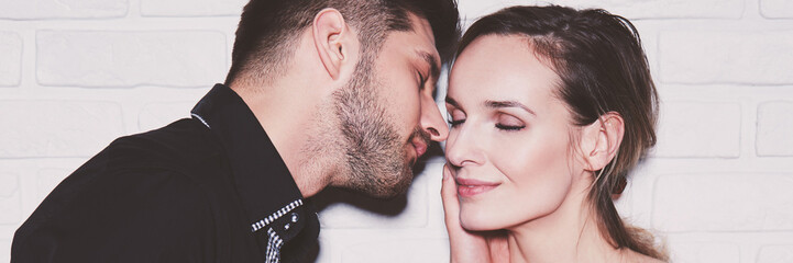 Couple kissing with closed eyes