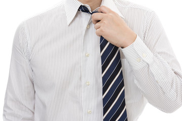 ネクタイを緩めるビジネスマン