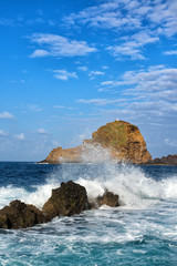 lighthouse and rock in porto moniz in madeira
