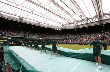 Men's Singles - General view as ground staff remove the covers after the roof is closed