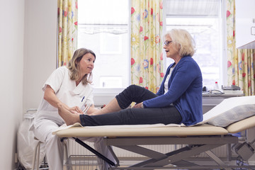 Senior woman with doctor during medical procedure