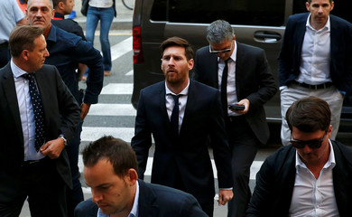 Barcelona's Argentine soccer player Lionel Messi arrives to court with his father Jorge Horacio Messi to stand trial for tax fraud in Barcelona