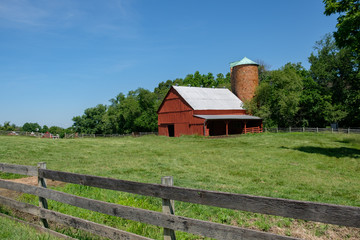 Barn and pasture with old wooden fence