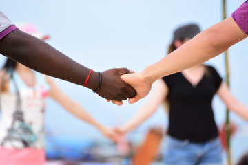man and girl hold hand blur background
