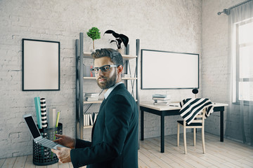 Man with laptop in modern interior