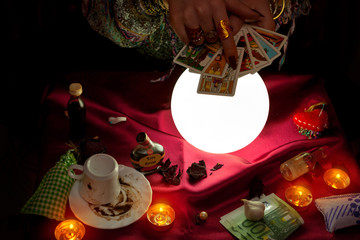 Woman soothsayer holding tarot cards for future reading