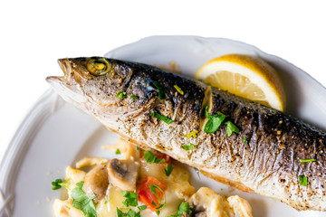Baked fish mackerel with lemon