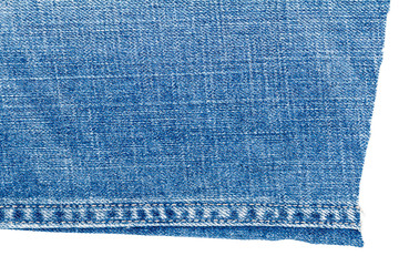 Piece of light blue jeans fabric