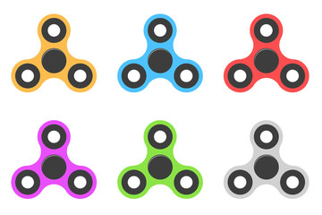 Spinner. A modern anti-stress toy in a flat style. A toy for hands and fingers. Bearing system. Set of multi-colored spinners isolated on white background