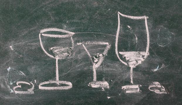 Wine glasses on chalkboard, blackboard, texture and background