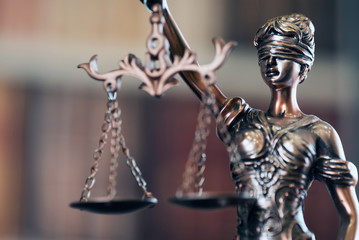 Lady Justice and law books in court