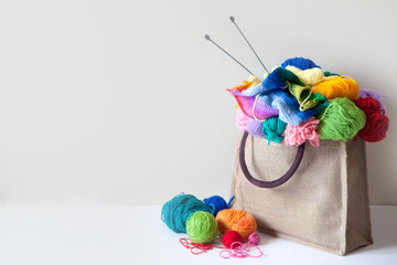 Balls of colored yarn are in the basket. Do needlework. Everything for handmade.