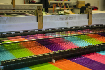 Modern weaving machine producing elaberate patterned textile for the World markets