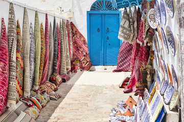 yard with carpets and blue door in Tunisia