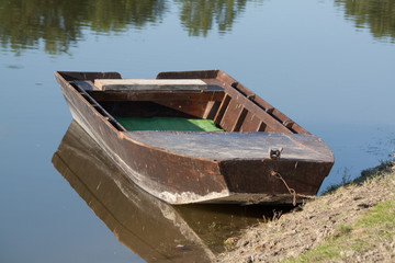 wooden boat in the water at the river