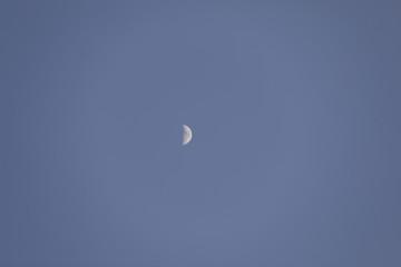 Half moon blue sky