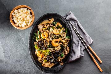 Chinese food. Pan of fried beef, pork, chicken, shiitake mushrooms, prawns and spring onion
