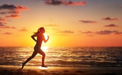 Runner Woman Running In The Beach At Sunset