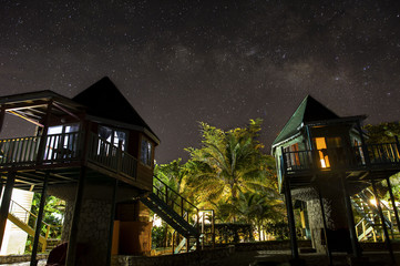 The Milky Way Behind Jamaican Cottages on the Coast