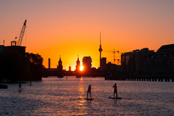 Sunset sky Berlin Panorama - river Spree, Oberbaum Bridge, Tv Tower and stand up paddle board people