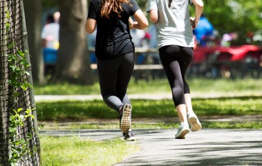 Two women running in a park