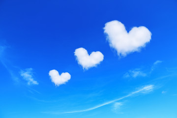three white heart shaped clouds on blue sky,love concept