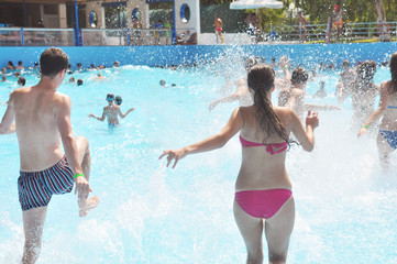 Young people in pool - teenage, fun, swimming suit, summer vacation, sea, sand