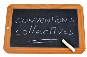 Conventions collectives écrit sur une ardoise sur laquelle est posée une craie