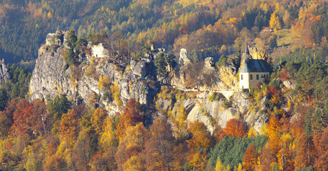 View of a Bohemian Vranov Castle on the rocky ridge at autumnal time