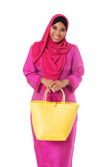 Asian muslimah woman with yellow wicker tote bag.Isolated
