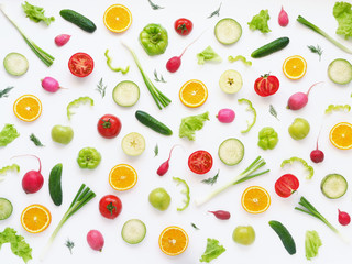 Fototapete - Vegetables and fruits on a white background. Pattern of vegetables and fruits. Food background. Collage of food. Top view.  Composition of pears, green peppers, cucumbers, green radish, tomatoes, gree
