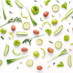 Fototapete - Vegetables and fruits on a white background. Pattern of vegetables and fruits. Food background.  Top view. Food collage of potato, green radish, pepper, lettuce, cucumber, green apples, onion.