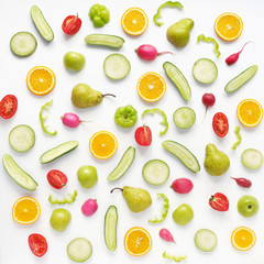 Fototapete - Vegetables and fruits on a white background. Pattern of vegetables and fruits. Abstract food background. Collage of food. Top view. Composition of pears, green peppers, cucumbers, green radish, tomato