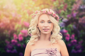 Young Blonde Woman with Flower Wreath and Sunlight Outdoors