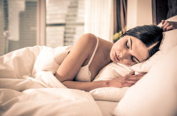 Woman sleeping and dreaming in bed