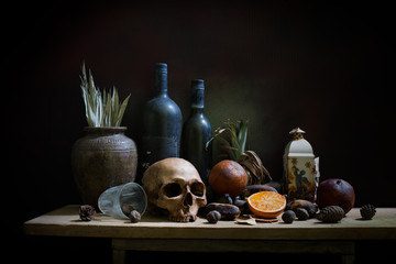 Skull and objects expired and dried and rotten fruits on the plank in dim light night / Still life style  and select focus, space for text.
