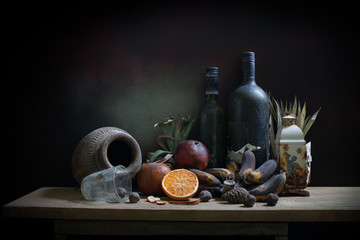 Objects expired and dried and rotten fruits on the plank in dim light night / Still life style  and select focus .