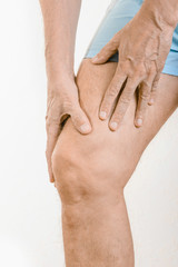 Athlete man feeling pain to the quadriceps