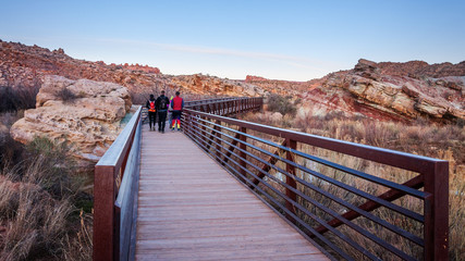 People waking on one of the bridges on the trail towards the Delicate Arch in Arches National Park.