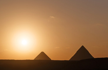 landscape with two pyramids at sunrise