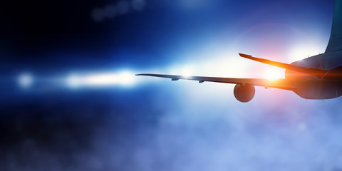 Airliner in night sky Wall mural
