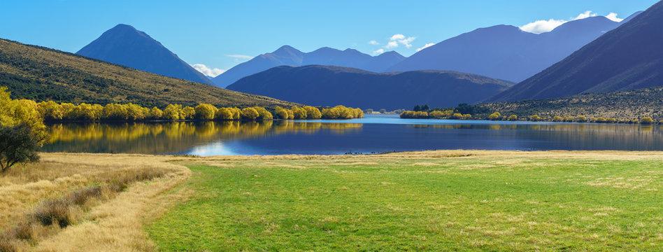 Panoramic image of beautiful scenery of Lake Pearson (Moana Rua) in Autumn , Arthur's pass National Park , South Island of New Zealand