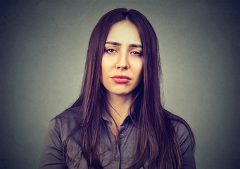 Closeup of a sad bored woman