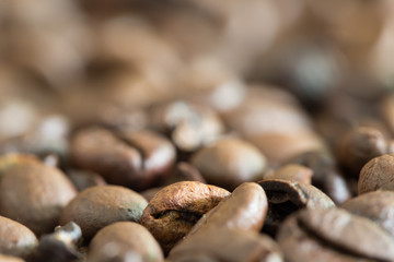 Pile of coffee seeds / Blurred and solf and select focus for background ..