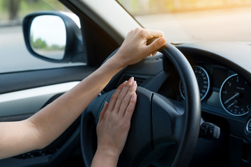 closeup of woman hands behind the wheel.  concept of lifestyle.