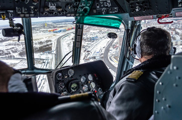 Helicopter mi-8 inside cockpit in flight, Russia, Tyumen November 2013.