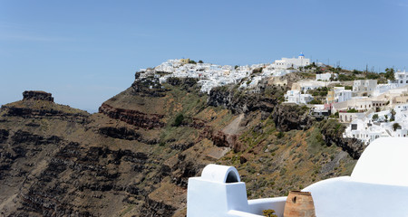Cityscape of Fira, town at Santorini Isle (Greece) with typical white houses